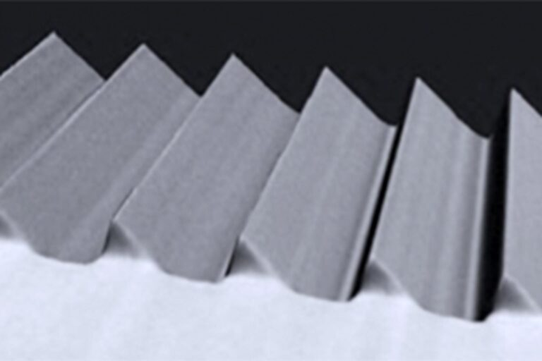 A diffraction grating patterned with DWL 66+. Both the angle of the sawtooth-like profile and the groove spacing are tuned to match the specific application requirements. Blazed gratings are key components of many optical instruments, such as monochromators and spectrometers used in sensors, communication systems and other tools. (Courtesy of IGI)