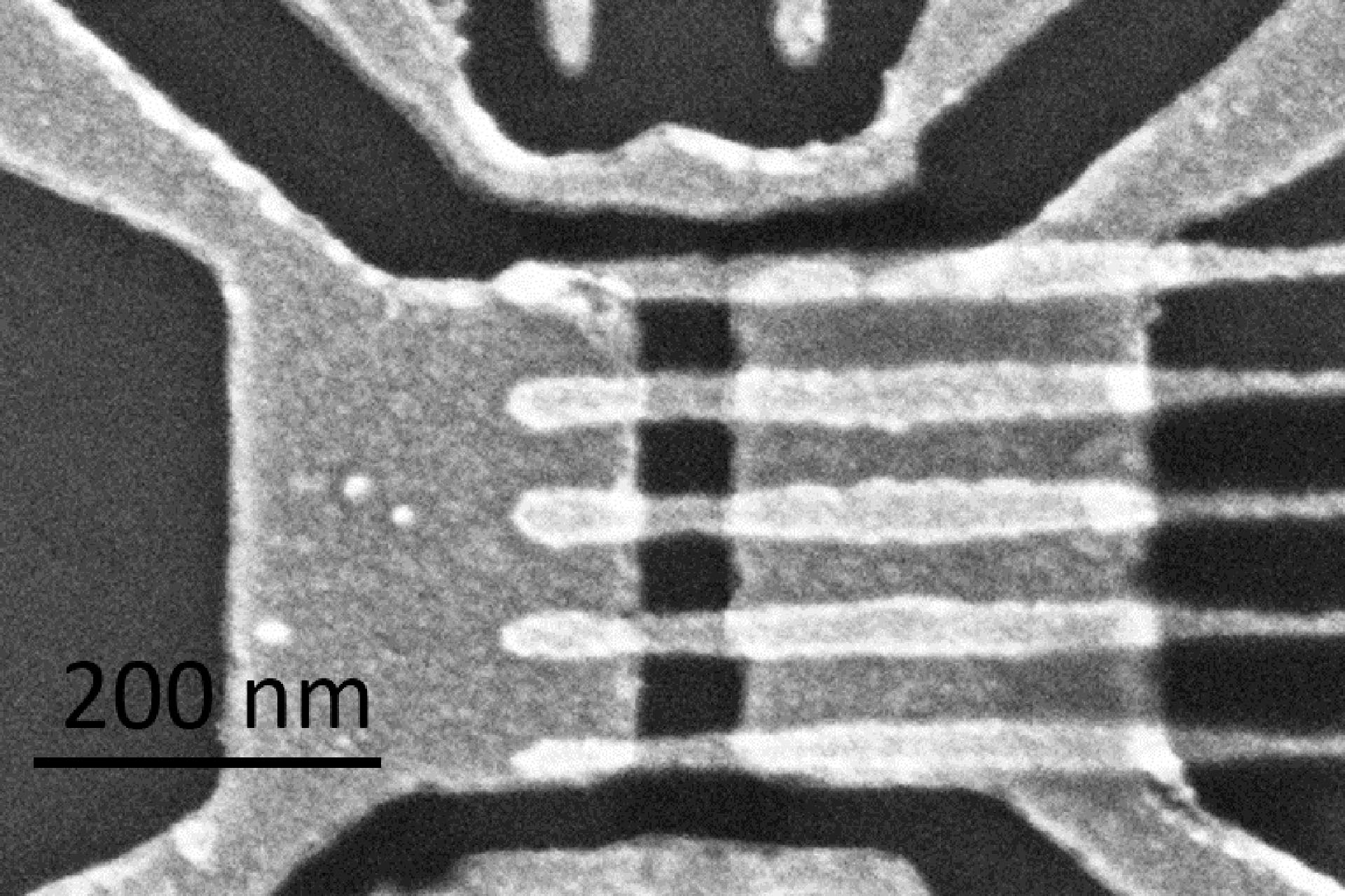 Quantum bus in silicon with an array of gate electrodes atop metal leads fabricated previously by electron beam lithography. (Courtesy of Heidelberg Instruments Nano & Dr. Lars Schreiber, RWTH Aachen, Germany)