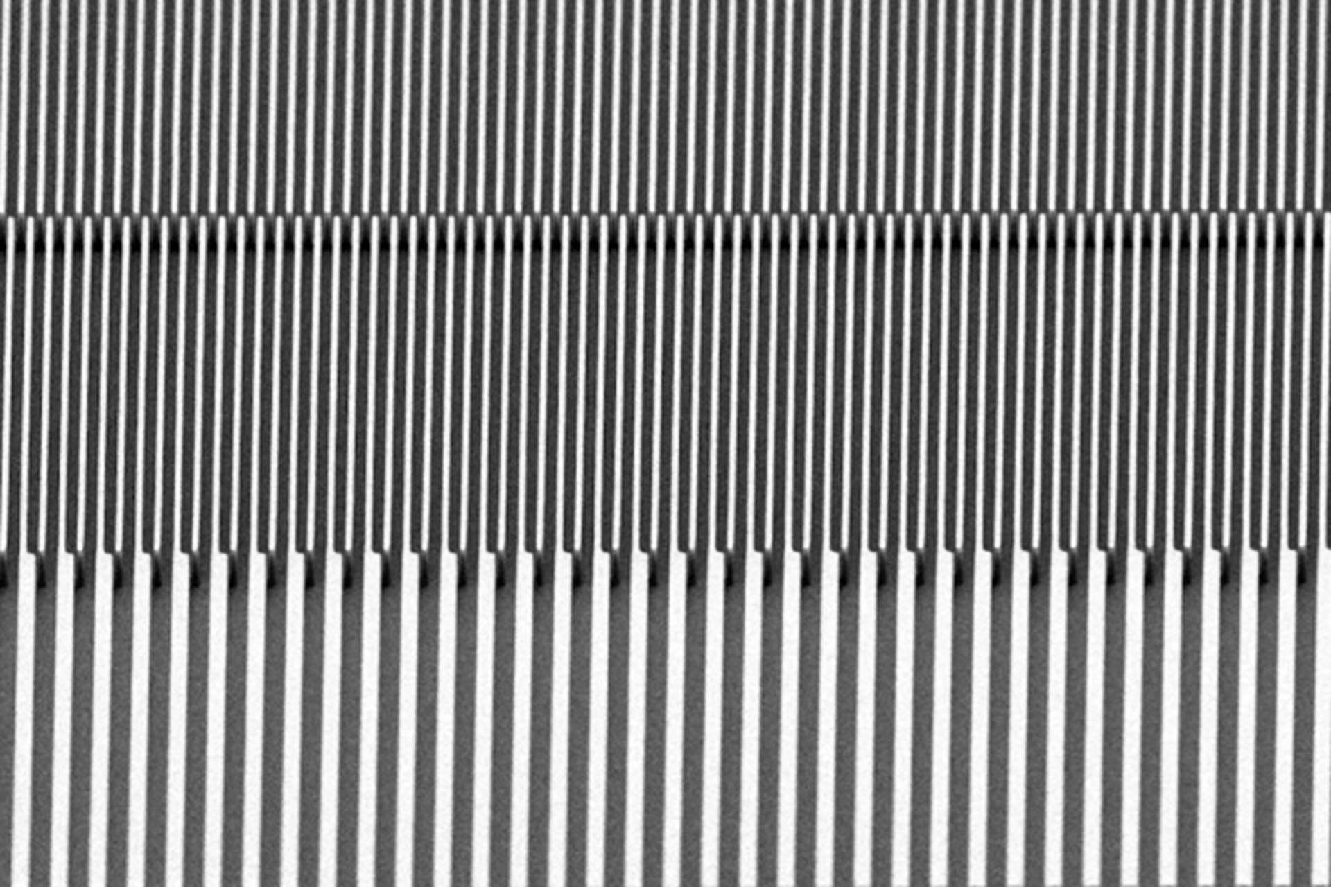 Exposure of 10-µm-thick resist (AZ 9260) with 2 µm and 4 µm lines and spaces. (Courtesy of CMi EPFL)