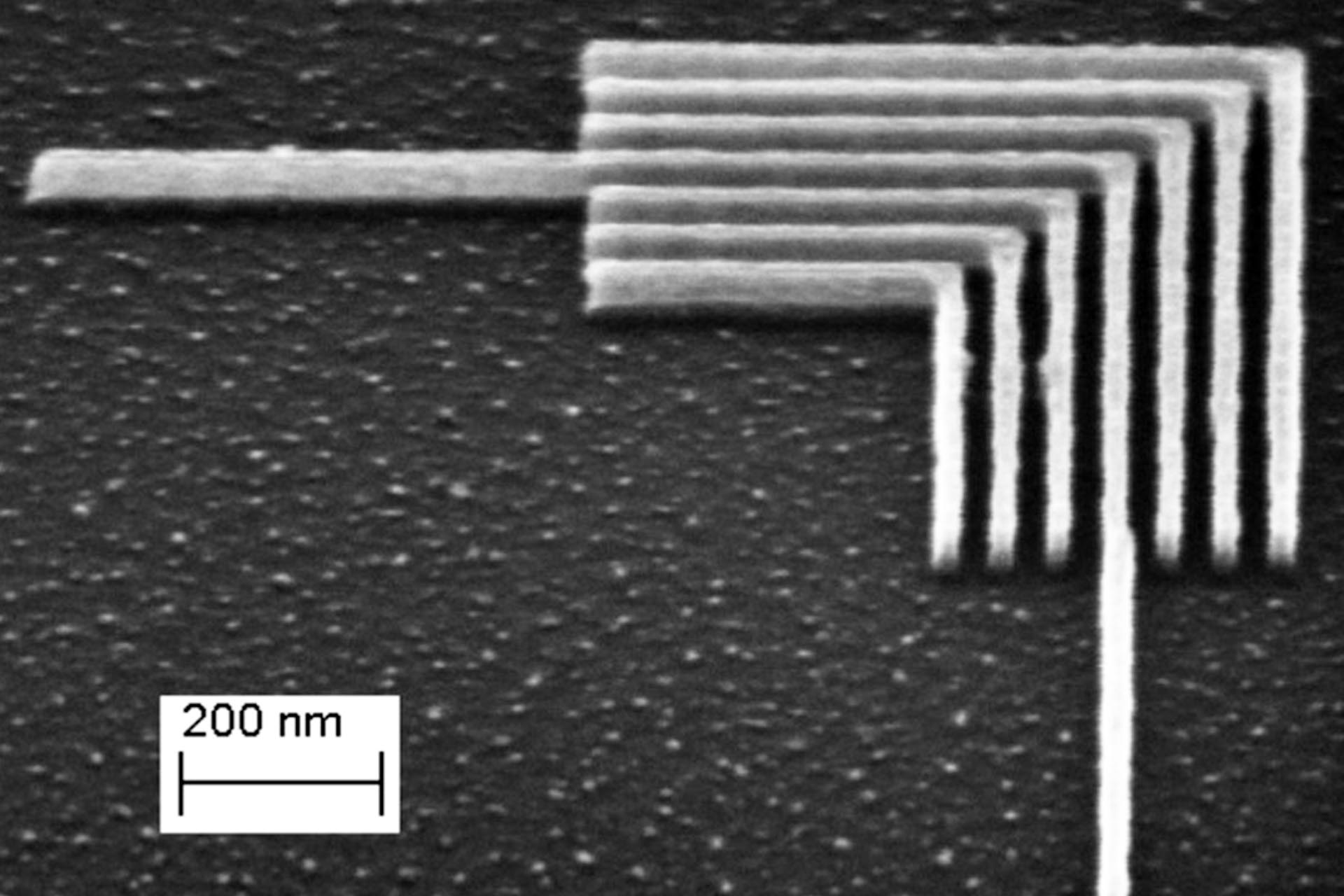 A tilted SEM image of nested L-structures etched into silicon (Courtesy of IBM Research Zurich & Heidelberg Instruments Nano)