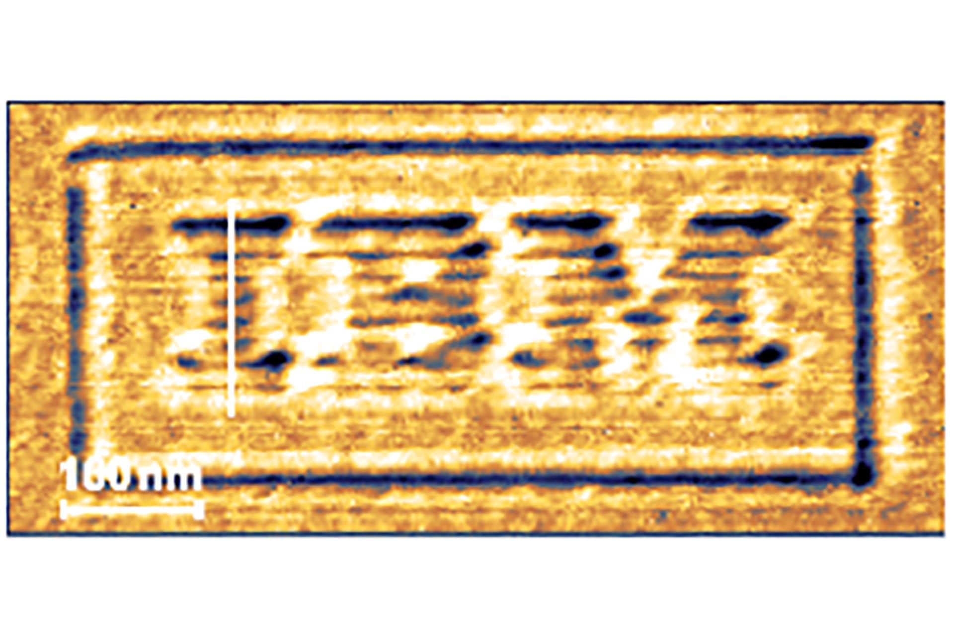 NanoFrazor AFM image of IBM logo written 4 nm deep into PPA resist with 8 nm half-pitch resolution.