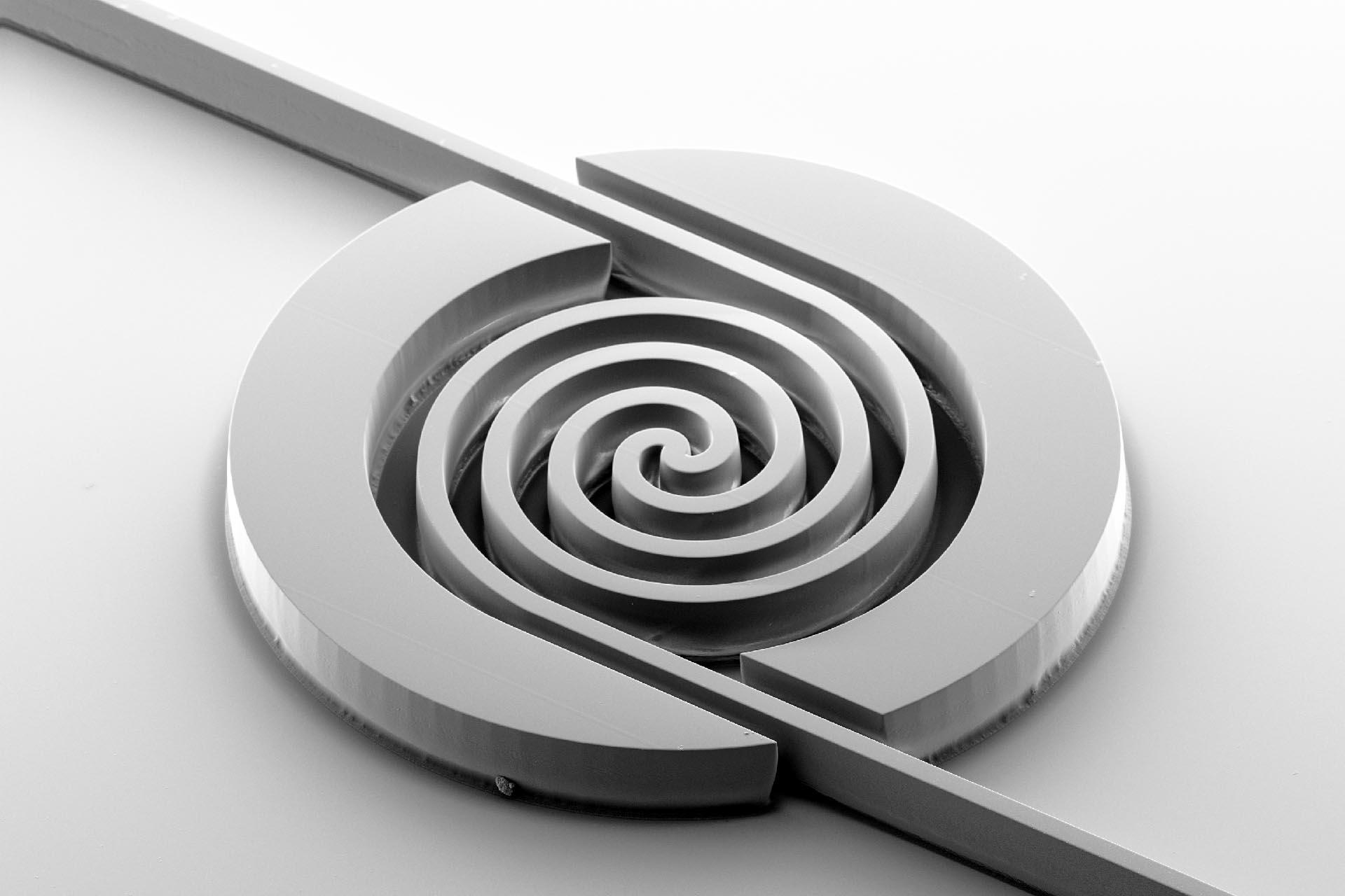 Spiral delay line for waveguides