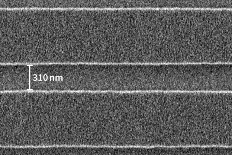 SEM image of 1:3 clear/dark pattern in IP 3250 resist showing an isolated line width of 310nm. (Courtesy of IMS Chips)