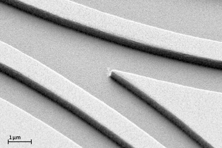 SEM image of a waveguide pattern exposed in a 550 nm thick positive resist showing nice smooth edges and sharp vertical walls. (Courtesy of IMS Chips)